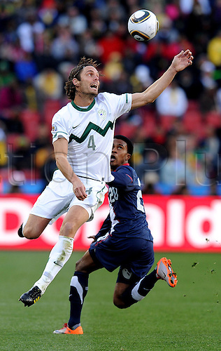Marko Suler of Slovenia fights for the ball with Robbie Findley of USA during the FIFA World Cup 2010 soccer match between Slovenia and USA at Ellis Park Stadium on June 18, 2010 in Johannesburg, South Africa.  Photo GPA/Luca Ghidoni