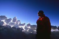 Rob Hahn enjoying the last rays of sun before sneaking in his bivy bag at Camp Sherman, Mt Rainier, Washington, USA.