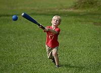 NWA Democrat-Gazette/BEN GOFF @NWABENGOFF<br /> Liam Philippon, 4, of Bella Vista takes a swing on Sunday Aug. 23, 2015 while practicing hitting a foam baseball with his dad at Lake Bella Vista in Bentonville.
