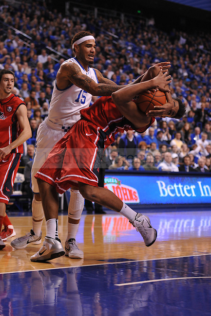 UK forward Willie Cauley-Stein (15) struggles to pull the ball away from Ole Miss forward Sebastian Saiz (11) during the first half of the UK men's basketball team vs Ole Miss at Rupp Arena in Lexington, Ky., on Tuesday, February 4, 2014. Photo by Eleanor Hasken | Staff
