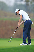 Ross Fisher (ENG) putts on the 14th green during Friday's Round 2 of the 2014 BMW Masters held at Lake Malaren, Shanghai, China 31st October 2014.<br /> Picture: Eoin Clarke www.golffile.ie