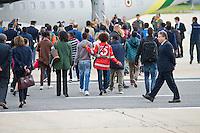 Rome, Italy, October 9, 2015. Rifugiati eitri in attesa di essere imbarcati su un volo per la Svezia. Questa è stata la prima attuazione del piano europeo per il ricollocamento dei migranti: dall'Italia in due anni dovranno essere 39.600 quelli che si sposteranno in altri Paesi europei. Eritrean refugee pose for a group photo in front of an Italian Financial police aircraft which will take them to Sweden, at Rome's Ciampino airport. The aircraft, carrying 19 Eritreans, will bring the first refugees to Sweden under the European Union's new resettlement program aimed at redistributing asylum-seekers from hard-hit receiving countries.