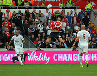 Pictured: Marouane Fellaini of Manchester United (C) controls the ball with his chest, watched on my Ashley Williams (L) and Jonjo Shelvey of Swansea Sunday 30 August 2015<br /> Re: Premier League, Swansea v Manchester United at the Liberty Stadium, Swansea, UK