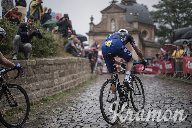Niki Terpstra (NED/Etixx-QuickStep) charging up the infamous Kapelmuur (Muur van Geraardsbergen) in the rain<br /> Notice how he doesn't wear a race number... a fact he apologised to the UCI commisaire about during the race<br /> <br /> 12th Eneco Tour 2016 (UCI World Tour)<br /> Stage 7: Bornem › Geraardsbergen (198km)