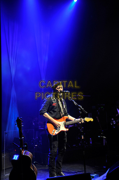 Richard Thompson.performing in concert, Shepherd's Bush Empire, London, England. .25th February 2013.on stage lie gig performance music length hat flat cap scarf black shirt full trousers singing guitar goatee facial hair .CAP/MAR.© Martin Harris/Capital Pictures.