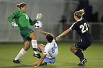 9 November 2007: North Carolina's Casey Nogueira (54) squeezes a shot between Virginia's Nikki Krzysik (23) and goalkeeper Chantel Jones (29), but the shot went wide of the goal. The University of North Carolina tied the University of Virginia 1-1 at the Disney Wide World of Sports complex in Orlando, FL in an Atlantic Coast Conference tournament semifinal match.  UNC advanced to the finals on penalty kicks, 4-2.