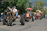 Larry Borowick with his 1927 Farmall Regular tractor and flags leads a group of Cockshutt tractors during the Carson Valley Days parade downtown Minden, Nevada.