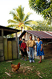 BELIZE, Punta Gorda, Toledo District, Cosme and Selestina Cho with their sons in front of their home in the Maya village of San Jose