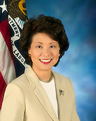 Washington, D.C. - OFFICIAL PORTRAIT OF SECRETARY OF LABOR ELAINE CHAO -- Elaine L. Chao is the Nation's 24th Secretary of Labor and the first Asian American woman appointed to a President's cabinet in United States history. Arriving at the age of eight from Asia speaking no English, Secretary Chao's experience transitioning to a new country inspired her to dedicate most of her professional life to ensuring that people have access to opportunity and the chance to build better lives.  Since her confirmation by the United States Senate on January 29, 2001, she has been dedicated to carrying out the Department of Labor's mission of promoting and protecting the health, safety, retirement security, and competitiveness of the nation's workforce.  Among many other accomplishments under her tenure, the Labor Department updated the white collar exemption of the Fair Labor Standards Act, which has been on the agenda of every Administration since 1977. The most significant regulatory tort reform of President Bush's first term, the new regulations provided millions of low-wage vulnerable workers with strengthened overtime protection. In 2003, the Department achieved the first major update of union financial disclosure regulations in more than 40 years, giving rank and file members enhanced information on how their hard-earned dues are spent. And under her leadership, the Department has set new worker protection enforcement results, including recovering record back wages for low wage immigrant workers. The Department has also launched comprehensive reform of the nation's publicly funded worker training programs, to better serve dislocated and unemployed workers.  Secretary Chao's career has spanned the public, private and non-profit sectors. As President and Chief Executive Officer of United Way of America, she restored public trust and confidence in one of the nation's largest institution of private charitable giving after it was tarnished by mismanagement and financial abuse.