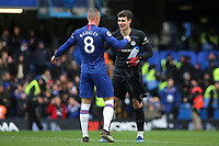 Chelsea goalkeeper, Kepa Arrizabalaga celebrates their victory with Ross Barkley at the final whistle during Chelsea vs Everton, Premier League Football at Stamford Bridge on 8th March 2020