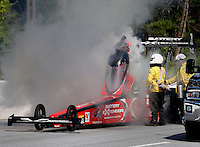 May 19, 2014; Commerce, GA, USA; NHRA top fuel driver Spencer Massey reacts upon learning from a member of the safety safari that he was the winner of the Southern Nationals at Atlanta Dragway. Mandatory Credit: Mark J. Rebilas-USA TODAY Sports