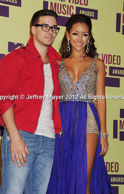 LOS ANGELES, CA - SEPTEMBER 06: Vinny Guadagnino and Melanie Iglesias pose in the press room during the 2012 MTV Video Music Awards at Staples Center on September 6, 2012 in Los Angeles, California.