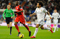 Real Madrid´s Marcelo Vieira and Sevilla's Stephane Mbia during 2014-15 La Liga match between Real Madrid and Sevilla at Santiago Bernabeu stadium in Alcorcon, Madrid, Spain. February 04, 2015. (ALTERPHOTOS/Luis Fernandez) /NORTEphoto.com
