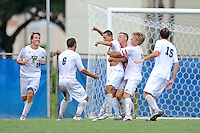 2 October 2011:  FIU's team (pictured from left to right, John Kite (15), Nicholas Chase (8), Quentin Albrecht (22, hugging De Sousa), Anthony Hobbs (16), and John Kite (15)), celebrates an overtime goal by Roberto De Sousa (20, center) as the FIU Golden Panthers defeated the University of Kentucky Wildcats, 1-0 in overtime, at University Park Stadium in Miami, Florida.