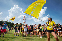 Participants of MSU's New Maroon Camp get ready for the &quot;family olympics&quot; event by waving team flags and cheering. An annual event since 2014, the week-long, student-led retreat helps first-year students transition to Mississippi State. Students learn MSU history and traditions, meet other new students, discover opportunities to get involved and learn about the MSU campus.<br />
