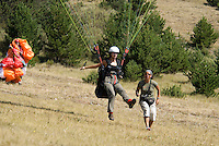 Saint Vincent-les-Forts, Lac de Serre Poncon, France, September 2007. Instructor Aniek Peters, guides a student into the air.  Volantis is home to the paragliding school Inferno. In one week time, students learn to fly the paraglider and earn their mountain licence 1. Photo by Frits Meyst/Adventure4ever.com