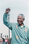 DURBAN, SOUTH AFRICA - APRIL 21: Nelson Mandela acknowledges a crowd of ANC supporters April 21, 1994 at a pre-election rally in Durban days before the historic democratic election on April 27, 1994 in South Africa. Mr Mandela became the first black democratic elected president in South Africa. He retired from office after one term in June 1999. (Photo by Per-Anders Pettersson)