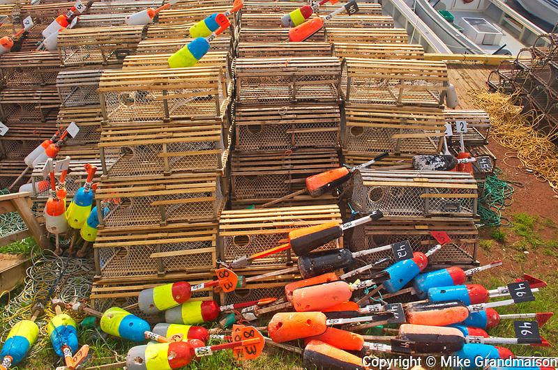 Lobster traps and buoys in coastal village<br />Sea Cow Pond<br />Prince Edward Island<br />Canada