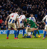 Watford's Will Hughes (centre) is tackled by Brighton & Hove Albion's Lewis Dunk in front of the Brighton & Hove Albion goal<br /> <br /> Photographer David Horton/CameraSport<br /> <br /> The Premier League - Brighton and Hove Albion v Watford - Saturday 2nd February 2019 - The Amex Stadium - Brighton<br /> <br /> World Copyright © 2019 CameraSport. All rights reserved. 43 Linden Ave. Countesthorpe. Leicester. England. LE8 5PG - Tel: +44 (0) 116 277 4147 - admin@camerasport.com - www.camerasport.com