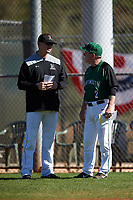 Dartmouth Big Green head coach Bob Whalen (2) talks with Northeastern Huskies head coach Mike Glavine (left) before a game on March 3, 2018 at North Charlotte Regional Park in Port Charlotte, Florida.  Northeastern defeated Dartmouth 10-8.  (Mike Janes/Four Seam Images)
