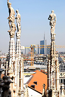 Milano/Italy 15 aprile 2015<br /> Nuova skyline di Milano. Veduta dalla sommità del Duomo. In primo piano le guglie e le case del centro storico. Sullo sfondo i nuovi grattacieli costruiti nel quartiere Isola / Garibaldi.<br /> New skyline of Milan. View from the top of the Duomo. In the foreground pinnacles and the houses of the old town. In the background the new skyscrapers built in the district Isola / Garibaldi. <br /> Photo Livio Senigalliesi