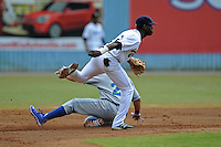 Asheville Tourists second baseman Juan Ciriaco #2 makes the turn on a double play over a hard sliding Cam Gallagher #25 during a game against the Lexington Legends at McCormick Field on June 16, 2013 in Asheville, North Carolina. The Tourists won the game 8-7. (Tony Farlow/Four Seam Images)