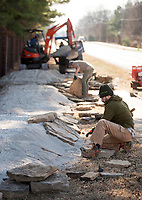 NWA Democrat-Gazette/BEN GOFF @NWABENGOFF<br /> Derek Lehecka works with a crew from Rock Solid Trail Contracting, LLC, to build new flow features Friday, Jan. 5, 2018, on the Ozone trail in Bentonville. The new features will make a more interesting line for riders on the relatively straight and flat section of the trail, part of the Slaughter Pen mountain bike trail system, where it runs beside Northwest A Street.