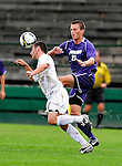 13 September 2009: University of New Hampshire Wildcats' midfielder Josh Bronner, a Sophomore from Belchertown, MA, heads the ball away from University of Portland Pilots' midfielder Jarad vanSchaik (21), a Junior from Tualatin, OR, during the second round of the 2009 Morgan Stanley Smith Barney Soccer Classic held at Centennial Field in Burlington, Vermont. The Pilots defeated the Wildcats 1-0 and inso doing were the Tournament Champions for 2009. Mandatory Photo Credit: Ed Wolfstein Photo