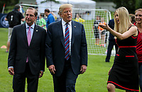 United States President Donald J. Trump, US Health And Human Services Secretary Alex Azar and Ivanka Trump walk as they watch young participants during the White House Sports and Fitness Day on the South Lawn on May 30, 2018 in Washington, DC.<br /> CAP/MPI/RS<br /> &copy;RS/MPI/Capital Pictures<br /> CAP/MPI/RS<br /> &copy;RS/MPI/Capital Pictures