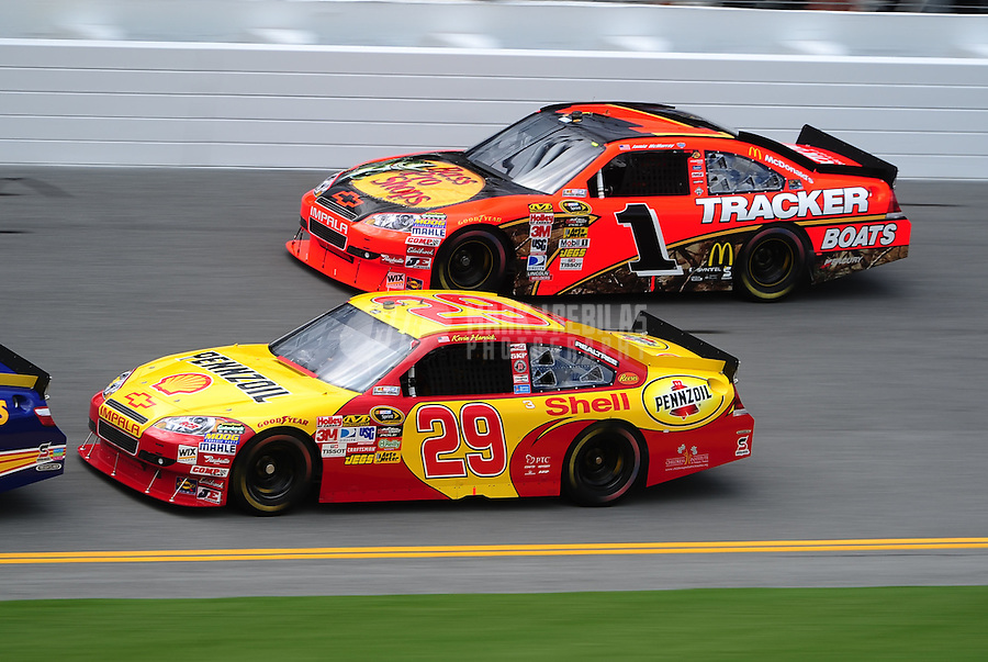Jul. 1, 2010; Daytona Beach, FL, USA; NASCAR Sprint Cup Series driver Kevin Harvick (29) races alongside teammate Jamie McMurray (1) during practice for the Coke Zero 400 at Daytona International Speedway. Mandatory Credit: Mark J. Rebilas-