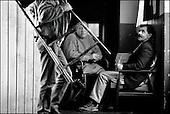 Hrubieszow,  South East Poland November 2005<br /> The faces of Polish poverty<br /> Unemployed men at the shelter for the poor and homeless in Hrubieszow<br /> ( &Scaron; Filip Cwik / Napo Images for Newsweek Polska)<br /> <br /> Hrubieszow k.Zamoscia 26 listopad 2005 Polska<br /> Oblicza biedy w Polsce<br /> Stowarzyszenie Przeciwdzialania Patologiom Spolecznym KRES prowadzi Ryszard Karpinski ktory wraz z czworka dzieci i zona mieszka w osrodku. Przebywa w nim 30 osob doroslych i 13 dzieci. Osrodek pobiera oplate w wysokosci 35 % przychodow mieszkanca /z emerytury , renty , zapomogi itp. /. Oferuje w zamian trzy cieple posilki dziennie, pokoj i ciepla wode.<br /> Wiekszosc Polakow niemal / 85% / z trudem radzi sobie z przezyciem od pierwszego do pierwszego. Ponad polowa / 52,5% / zalega ponad trzy miesiace z czynszem. Tyle samo osob, aby poprawic swoja sytuacje materialna radykalnie ogranicza wydatki. W beznadziejnej sytuacji jest ludnosc wiejska gdzie 18,5% zyje w skrajnej nedzy. W 1991 roku rzad polski zlikwidowal Panstwowe Gospodarstwa Rolne ktore od II Wojny Swiatowej byly miejscem pracy dla ponad 2 mln rolnikow glownie na ziemiach odzyskanych. Ci ludzie i ich rodziny nie odnalezli sie w nowej rzeczywistosci<br /> ( &Scaron; Filip Cwik / Napo Images dla Newsweek Polska)