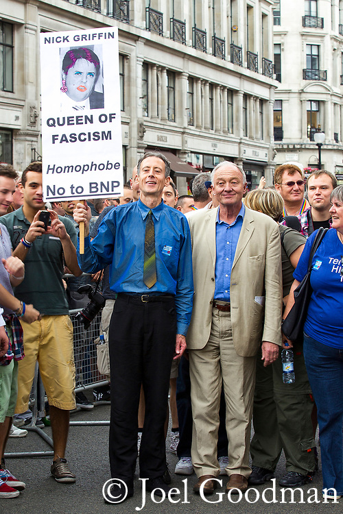 "© Joel Goodman - 07973 332324 . 02/07/2011 . London , UK . London mayor KEN LIVINGSTONE (r) and human rights campaigner PETER TATCHELL with a placard depicting BNP leader Nick Griffin as the "" Queen of Fascism "" . Tens of thousands take part in the annual Pride march in London . Photo credit : Joel Goodman"