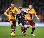 Jonathan Franks of Ross County sandwiched by Motherwell's Louis Molt and Steven Hammell