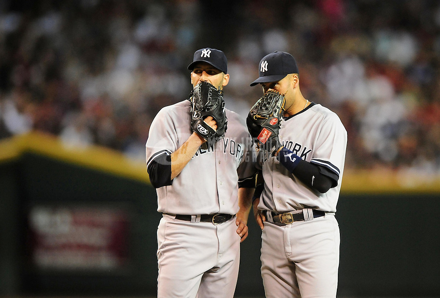 Jun. 22, 2010; Phoenix, AZ, USA; New York Yankees pitcher Andy Pettitte (left) with shortstop Derek Jeter against the Arizona Diamondbacks at Chase Field. The Yankees defeated the Diamondbacks 9-3. Mandatory Credit: Mark J. Rebilas-