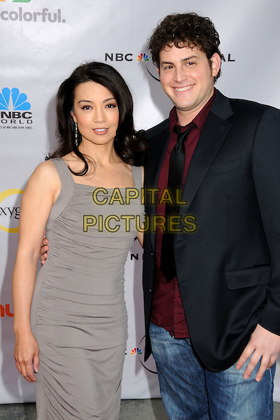 "MING-NA & DAVID BLUE.The Cable Show 2010 ""An Evening with NBC Universal"" held at Universal Studios Hollywood, Universal City, California, USA..May 12th, 2010.half 3/4 length grey gray dress ruched sleeveless black jeans denim black jacket tie red maroon shirt.CAP/ADM/BP.©Byron Purvis/AdMedia/Capital Pictures."