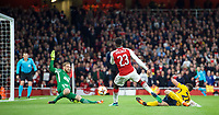 Danny Welbeck of Arsenal hits a shot at goal during the UEFA Europa League Semi Final 1st leg match between Arsenal and Atletico Madrid at the Emirates Stadium, London, England on 26 April 2018. Photo by Andy Aleksiejczuk / PRiME Media Images