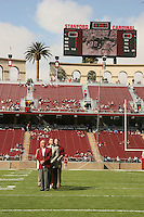 14 October 2006: Jeff Siemon receives his plaque for his College Football Hall of Fame induction during Stanford's 20-7 loss to Arizona during Homecoming at Stanford Stadium in Stanford, CA. Also pictured are his wife, Bob Bowlsby and John Ralston.