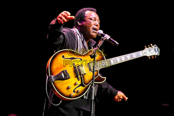 George Benson performing live in concert, Royal Albert Hall, Kensington, London, England. .28th June 2012.on stage in concert live gig performance music half length guitar black shirt singing profile hands arms.CAP/MAR.© Martin Harris/Capital Pictures.