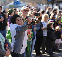 NWA Democrat-Gazette/ANDY SHUPE<br /> Kendall McAdams, 9, of Fayetteville catches a string of beads Saturday, Feb. 6, 2016, during the 15th Fat Saturday Parade of Fools organized by Fayetteville Mardi Gras in downtown Fayetteville. The 25th annual Fat Tuesday on Dickson Street is planned for 8 p.m. Tuesday beginning at Farrell's Lounge. Visit nwadg.com/photos to see more photographs from the parade.