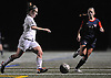 Wantagh No. 9 Amanda Lynch, left, gets pressured by South Side No. 11 Allison Mahoney during a Nassau County varsity girls' soccer Class A semifinal played at Cold Spring Harbor High School on Friday, October 30, 2015.<br /> <br /> James Escher
