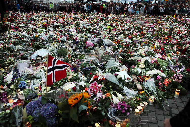 Tributes of flowers laid outside the Cathedral in central Oslo on the day that Anders Behring Breivik made his first court appearance following his arrest for two terrorist attacks on 22nd July 2011. A large vehicle bomb was detonated near the offices of Norwegian Prime Minister Jens Stoltenberg resulting in several injuries and deaths and a mass shooting attack claimed dozens of lives on Otoeya Island about 40 Kilometres from Oslo. Breivik confessed to carrying out both atrocities.