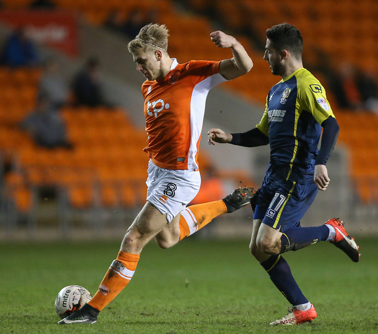 Blackpool's Brad Potts shoots at goal under pressure from Stevenage's Tom Pett<br /> <br /> Photographer Alex Dodd/CameraSport<br /> <br /> The EFL Sky Bet League Two - Blackpool v Stevenage - Tuesday 14th March 2017 - Bloomfield Road - Blackpool<br /> <br /> World Copyright &copy; 2017 CameraSport. All rights reserved. 43 Linden Ave. Countesthorpe. Leicester. England. LE8 5PG - Tel: +44 (0) 116 277 4147 - admin@camerasport.com - www.camerasport.com