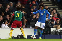Willian of Brazil and Chelsea and Gaetan Bong of Cameroon and Brighton & Hove Albion during Brazil vs Cameroon, International Friendly Match Football at stadium:mk on 20th November 2018