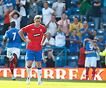 David Weir is gutted as Portsmouth celebrate their second goal after his botched clearance