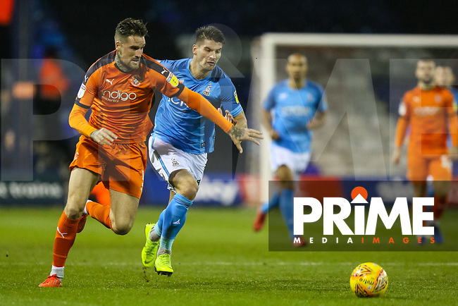 Sonny Bradley of Luton Town and Kai Bruenker of Bradford City during the Sky Bet League 1 match between Luton Town and Bradford City at Kenilworth Road, Luton, England on 27 November 2018. Photo by Thomas Gadd.
