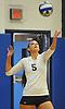 Plainview JFK No. 5 Maria Coniglio serves during a Nassau County varsity girls' volleyball match against Massapequa at Plainview JFK High School on Monday, October 19, 2015. Massapequa won 25-16, 25-8, 25-13.<br /> <br /> James Escher