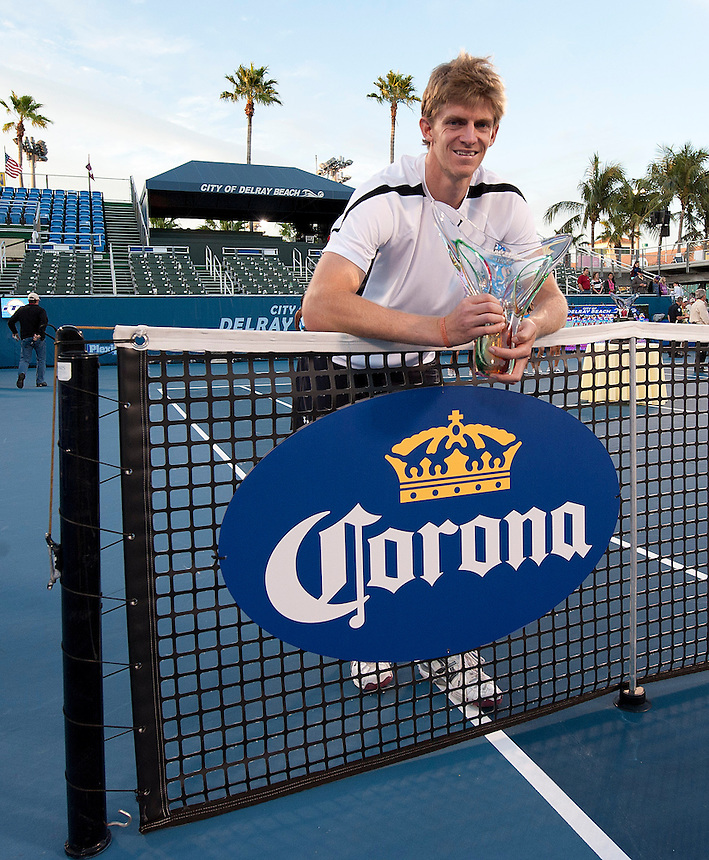 Kevin Anderson (RSA) poses with his trophy after his victory over Marinko Matosevic (AUS)  in their Final match today - Kevin Anderson (RSA) def Marinko Matosevic (AUS) 7-5 7-6(4)..ATP 250 Tennis - 2012 Delray Beach International Tennis Championships - Day 7 - Sunday 04 March 2012 - Delray Beach Stadium & Tennis Center - Delray Beach - Florida - USA..