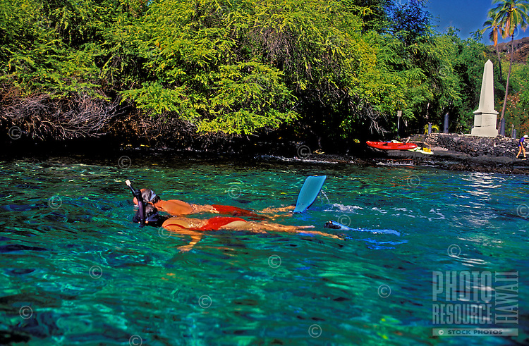 Couple snorkeling at Kealakekua bay near the Captain Cook monument just south of Kona on the Big island