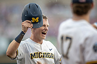 Michigan Wolverines first baseman Jimmy Kerr (15) celebrates after scoring against the Texas Tech Red Raiders during the first game of the NCAA College World Series on June 15, 2019 at TD Ameritrade Park in Omaha, Nebraska. Michigan defeated Texas Tech 5-3. (Andrew Woolley/Four Seam Images)