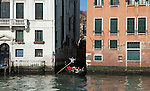 Venice-Italy - March 28, 2010 -- A gondola / gondolier with passengers / tourists glides into Grand Canal / Canal Grande (not: Canale Grande) -- infrastructure, transport, water, tourism -- Photo: © HorstWagner.eu